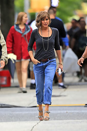 Gray platform sandals finished off Jennifer Aniston's casual-chic outfit.