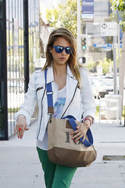 Jessica Alba looked uber cool in her mirrored blue Stun wayfarers while out in West Hollywood.