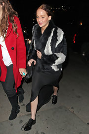 Jennifer Lawrence headed to a party at Chateau Marmont wearing a monochrome fur jacket.