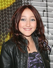 Noah Cyrus rocked a stylish center-parted wavy 'do while attending a birthday party.