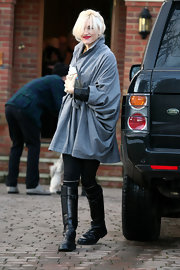 Gwen Stefani bundled up in cute style with this bluish-gray swing coat while visiting family in Buckinghamshire.