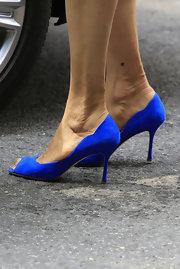 Actress Famke Janssen stepped outside her NYC hotel wearing pretty designer heels.