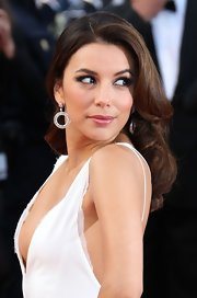 Eva Longoria accessorized with a pair of dangling diamond hoops by Damiani during the Cannes premiere of 'Rust and Bone.'