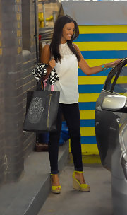Michelle Keegan completed her casual-chic attire with a pair of neon-yellow wedges.