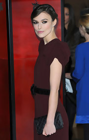Keira Knightley styled her dress with a quilted leather wallet by Chanel when she attended the UK premiere of 'A Dangerous Method.'