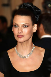 Linda Evangelista had her locks pulled up in a tight updo for the Met Gala.
