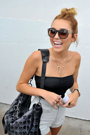 Miley Cyrus blinged up with with a load of wide-band rings by Maison Martin Margiela for a day out in Miami.