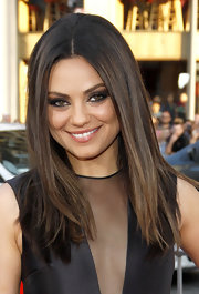 Mila Kunis played up her eyes with a heavy application of dark shadow.