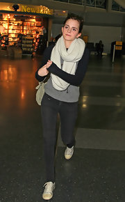 Emma Watson wore a sporty-luxe pair of Chanel Metallic Toile Weekend Trainers during a flight to New York.