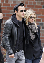 Jennifer Aniston geared up for a cold day with a gray pashmina.