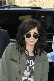 Demi Lovato headed to Z100 wearing a pair of square sunnies.