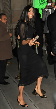 Famke Janssen smiled at the press wearing an LBD and a pair of satin peep-toes at the National Board of Review Awards.