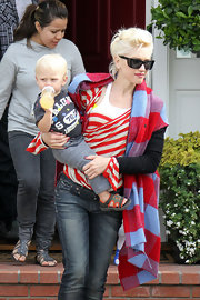Gwen Stefani sported a bold mix of patterns with this scarf and sweater combo during a trip to Long Beach.