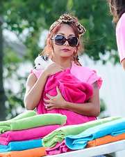Nicole Polizzi chic in her bedazzled, oversized sunnies while washing dogs for charity.