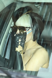 Lady Gaga accessorized with a pair of fingerless lace-up gloves while mingling with fans.