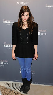 Astrid Berges Frisbey sealed off her look with a pair of black biker boots.