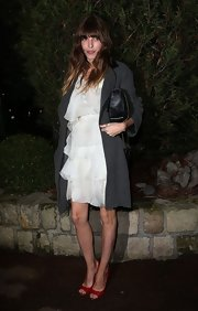 Lou Doillon arrived for the Sidaction Gala wearing a gray wool coat over a tiered LWD.