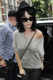 Katy Perry styled her casual outfit with a pearl pendant for a day out in London.