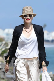 Gwen Stefani warded off the summer rays with a patterned straw hat, a pair of sunnies, and a black blazer while spending a day at the beach.