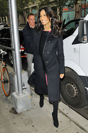 Padma Lakshmi arrived for her 'Wendy Williams' appearance wearing Christian Louboutin ankle boots with a military-inspired coat.