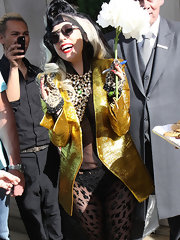 Lady Gaga completed her eclectic look with a pair of studded leopard-print gloves.