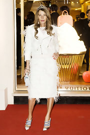 Anna dello Russo looked like a punk princess in a white feather skirt suit by Louis Vuitton, complete with a tiara, during the Maison Rome Etoile inauguration.
