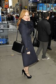 Jessica Chastain left the 'Good Morning America' studios sporting a black Marni shoulder bag, wool coat, and platform peep-toes combo.