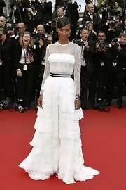 Liya Kebede went for ultra-feminine appeal at the 'Jeune & Jolie' premiere in a white Alberta Ferretti gown with a sheer bodice and a tiered skirt.