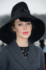 Ulyana Sergeenko dressed up her look with a bow-adorned black wide-brimmed hat when she attended the Viktor and Rolf fashion show.