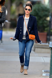 Rachel Bilson stepped out in Soho wearing a double-breasted navy blazer with cuffed jeans.