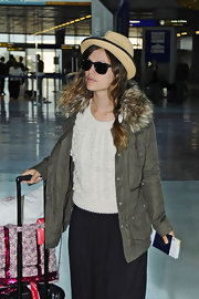 Rachel Bilson accessorized with a cute straw fedora during her flight to Nice.