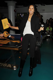 Padma Lakshmi rounded out her look with a pair of black knee-high boots.