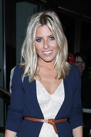 Mollie King accessorized with a skinny belt to highlight her tiny waist while attending the pre-Wimbledon party.