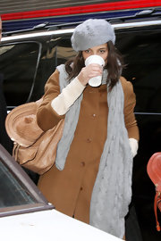 Katie Holmes stepped out on a cold day in New York City wearing a gray cable-knit scarf and a matching hat.