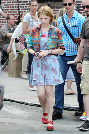 Anna Kendrick sported clashing patterns with this plaid button-down and print dress combo on the set of 'The Last Five Years.'