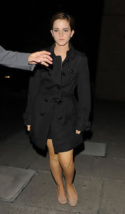 Emma Watson made her way to the 'Harry Potter' after-party wearing a black Burberry trenchcoat with patent piping.