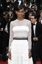 Liya Kebede attended the 'Jeune & Jolie' premiere wearing a lovely Repossi cuff with a frilly white dress.
