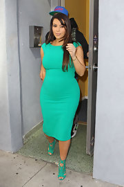 Going the matchy-matchy route, Kim Kardashian paired her dress with green suede cutout boots by Jimmy Choo.