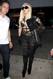Lady Gaga looked super seductive in a barely-there harness dress by Void of Course while enjoying a night out.