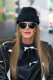 Anna dello Russo was winter-chic in a black fur hat and a pony-print sweater at the Kenzo fashion show.