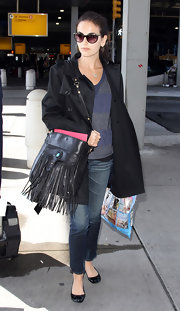 Camilla Belle chose a fringed black shoulder bag for her arm candy.