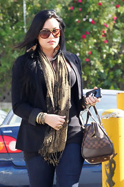 Demi Lovato stayed cozy with a patterned scarf by Pins & Needles while out shopping.