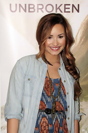 Demi Lovato finished off her look with an oversized gold pendant.