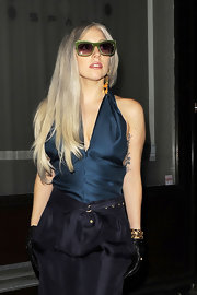 Lady Gaga added some glitz to her look with a gold cuff by Saint Laurent for a night out in London.