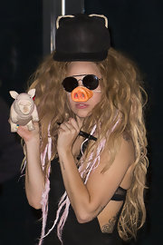 Lady Gaga sealed off her costume-y look with a piggy baseball cap.