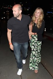 Rosie Huntington-Whiteley looked ready for summer in her tropical-print pants while enjoying a night out at Chateau Marmont.
