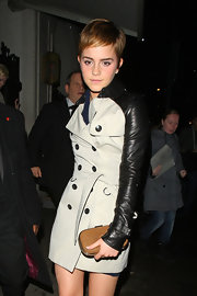 Emma Watson made a chic appearance at the Mahiki Nightclub with this tan hard-case clutch and two-tone trenchcoat combo.