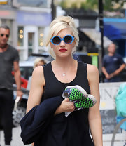 Gwen Stefani was spotted in London rocking a pair of blue-rimmed round sunnies.
