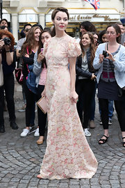 Ulyana Sergeenko looked demure and classy in a blush-colored Valentino lace gown during the label's fashion show.