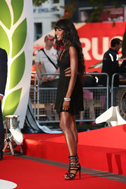 Naomi Campbell worked the red carpet in killer black gladiator heels during the London premiere of 'Rush.'
